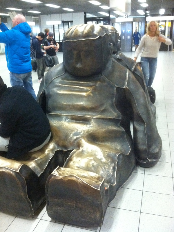 random scupture in amsterdam passport check